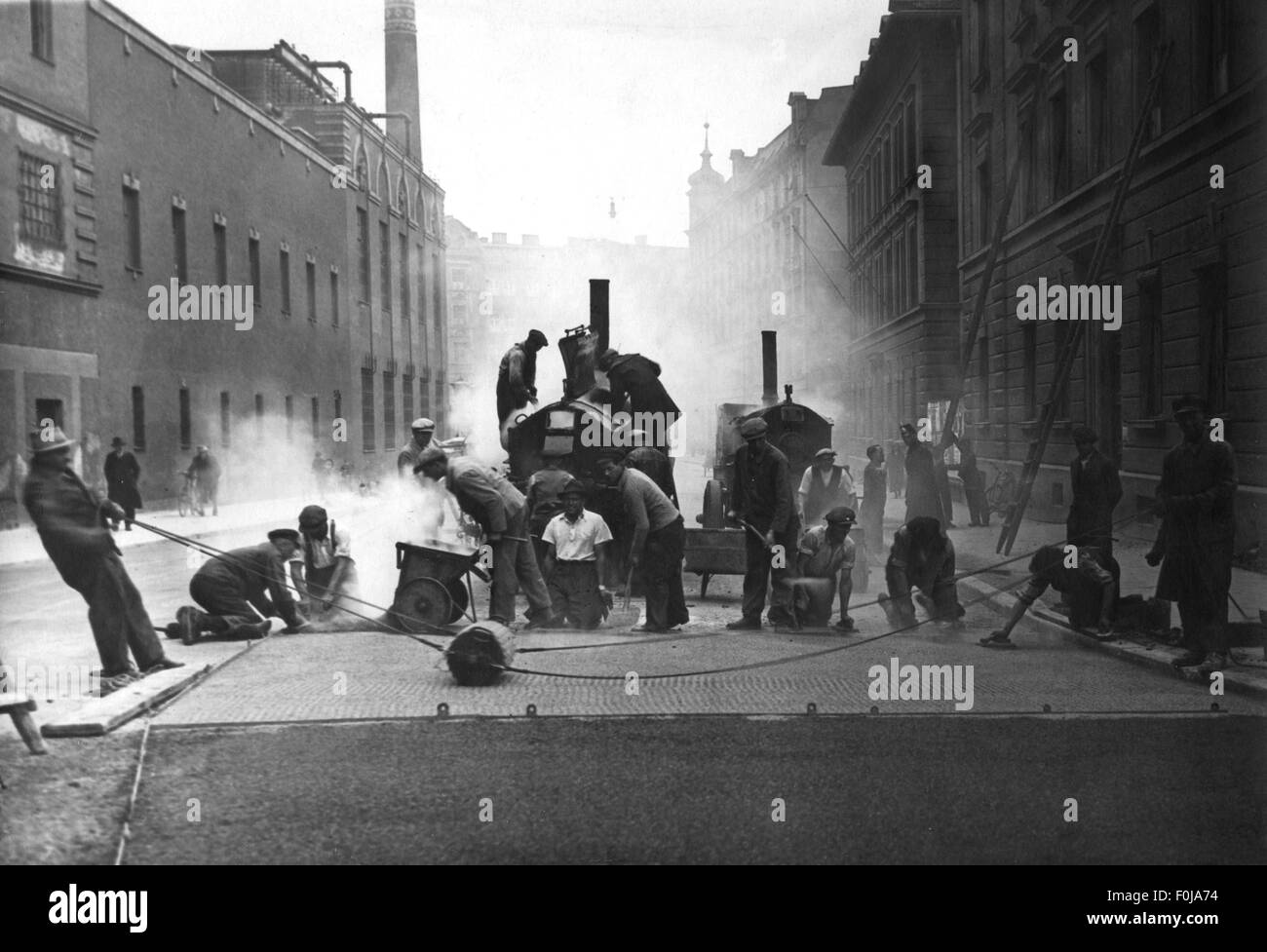 transport / transportation, road, road construction, mechanical roughening of the rough hard asphalt, circa 1934, - Stock Image