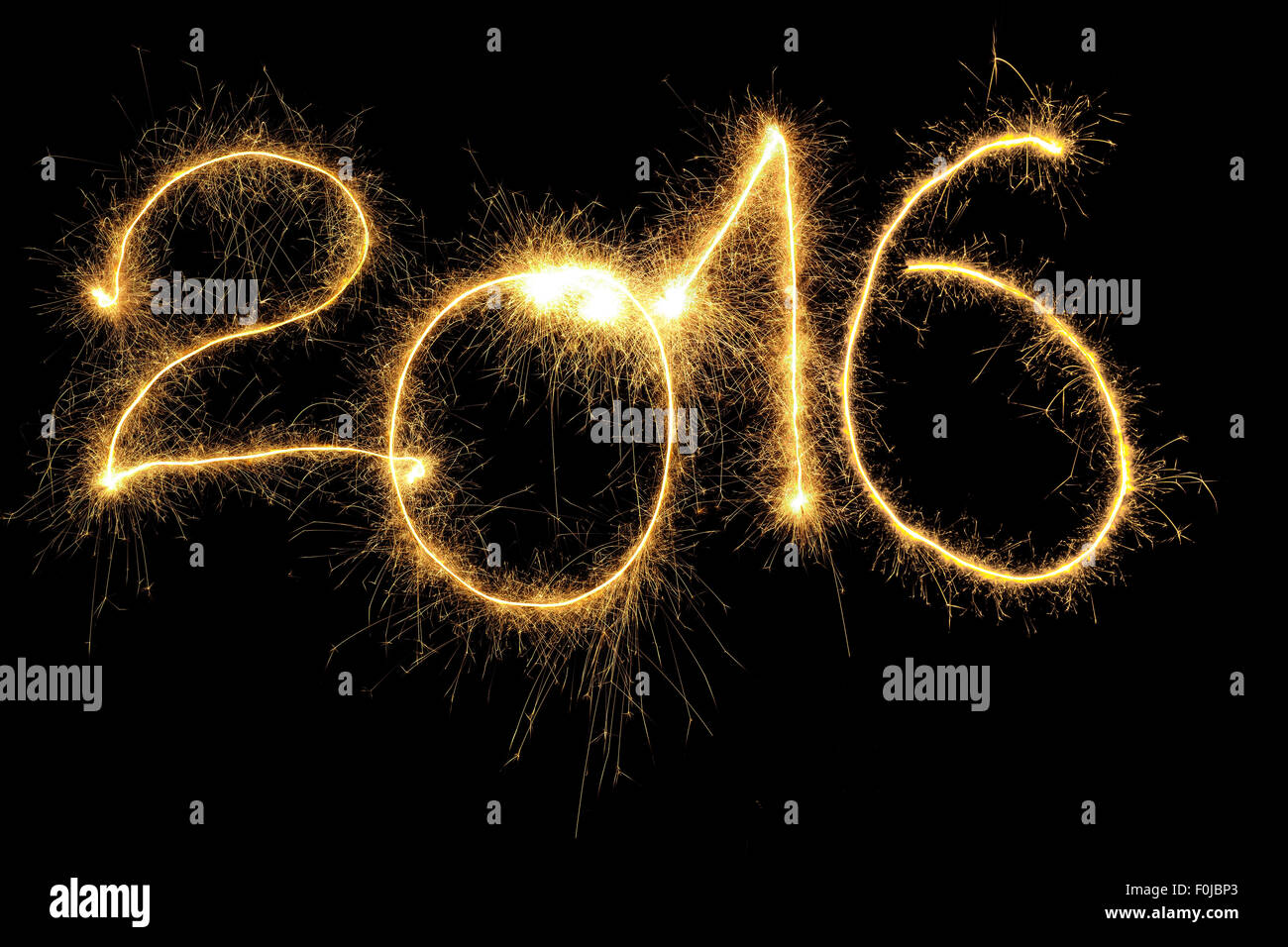 New Year 2016 formed from sparking digits over black background Stock Photo