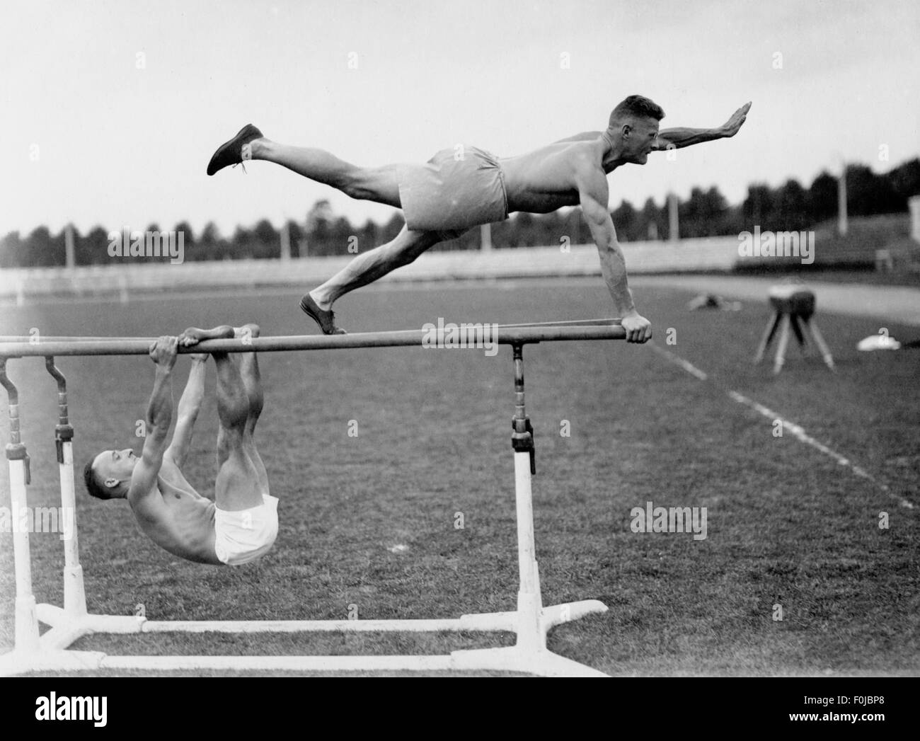 sports, gymnastics, men on the bars, Frankfurt stadium, 1920, Additional-Rights-Clearences-NA - Stock Image