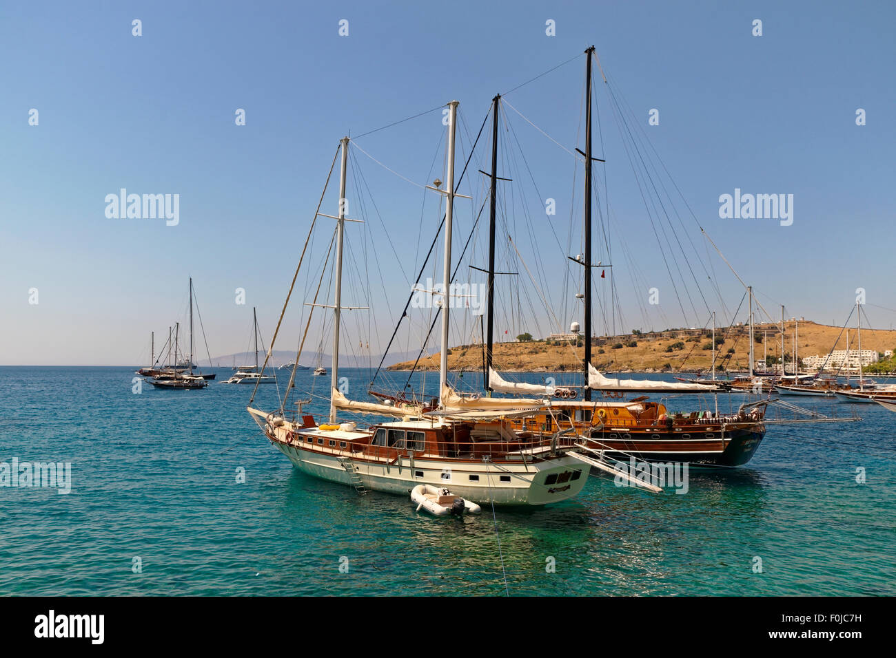 Gulets at anchor on the Aegean coast of Turkey. - Stock Image