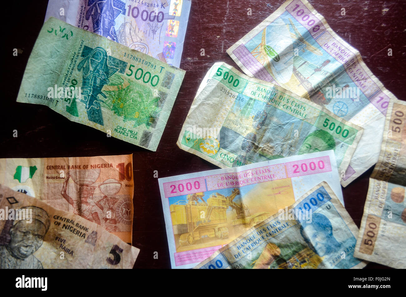 Bank notes of West Africa : Francs CFA fron West and Central Africa (XOF and XAF) and Nigerian naira - Stock Image