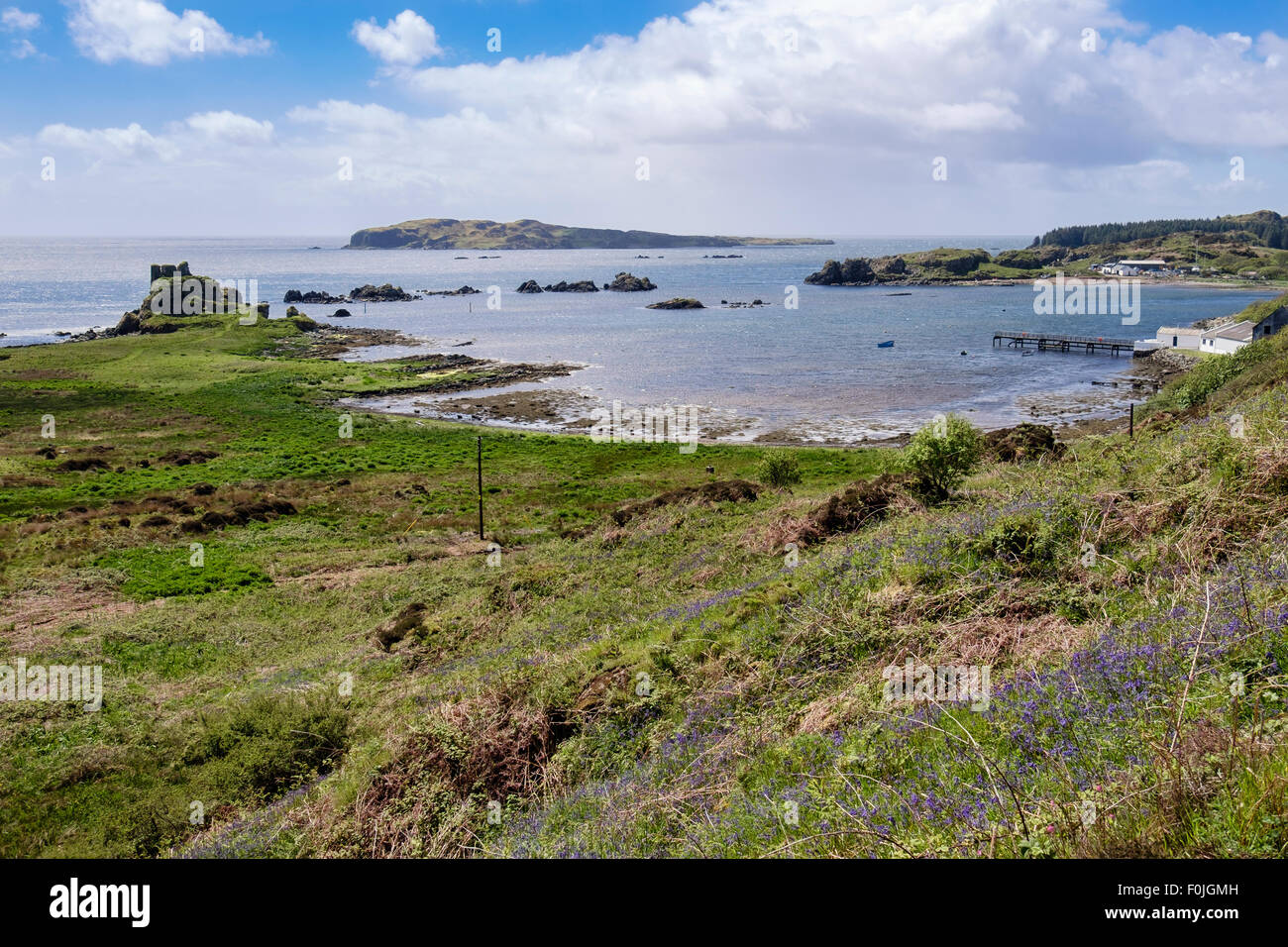 Dunyvaig castle overlooking a bay on southern coast with Texa island offshore. Lagavulin Isle of Islay Inner Hebrides - Stock Image