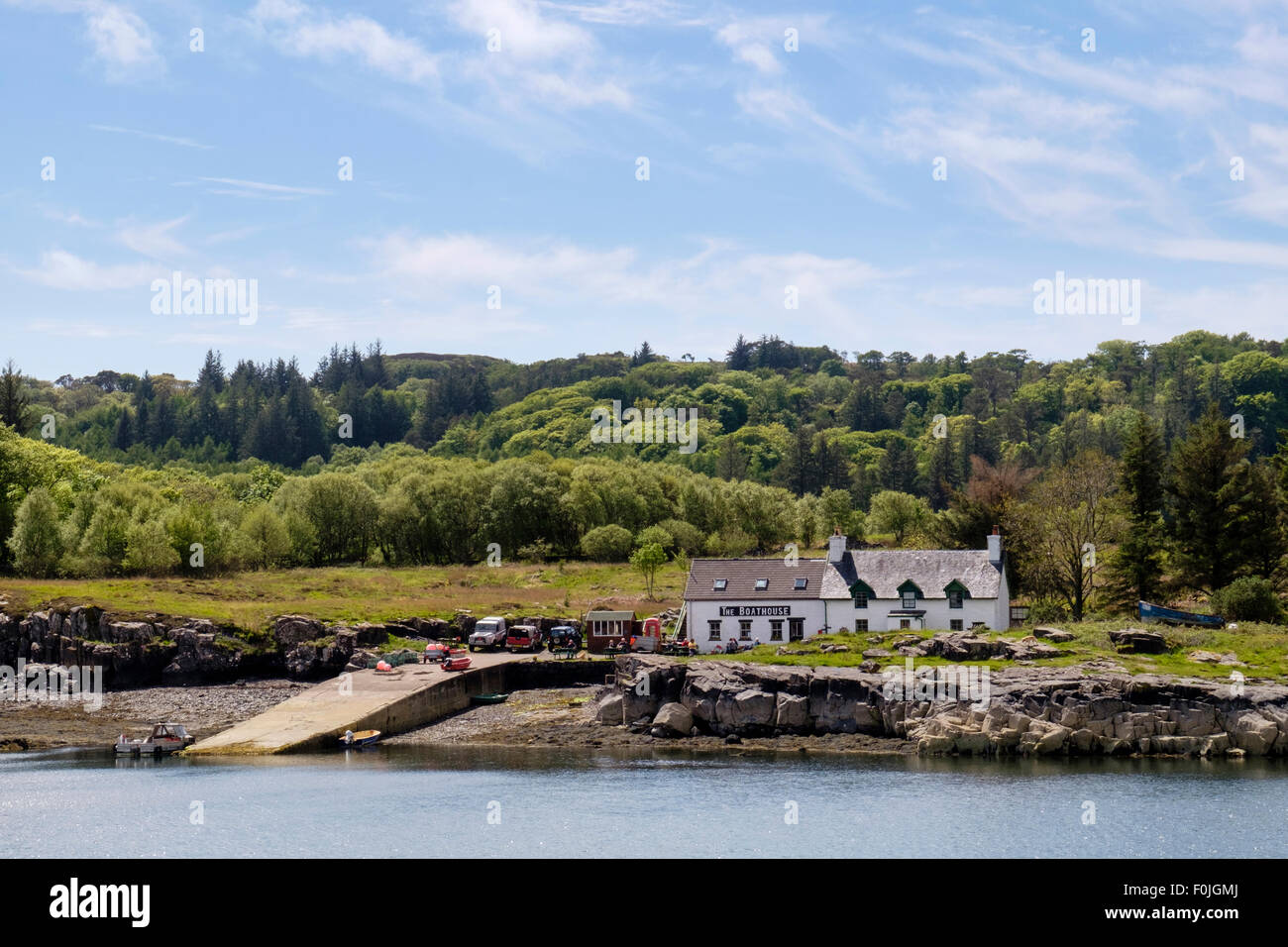 Looking across Ulva Sound to The Boathouse seafood restaurant by Ulva ferry jetty. Isle of Mull, Inner Hebrides, - Stock Image