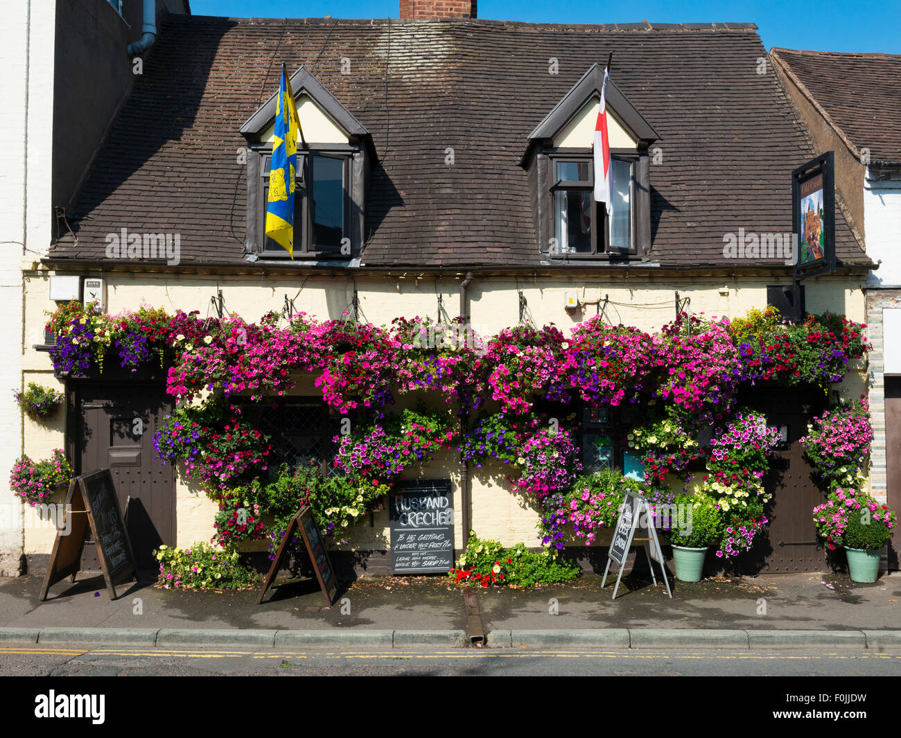 An array of hanging baskets outside the Old Castle pub in Bridgnorth, Shropshire, UK. - Stock Image