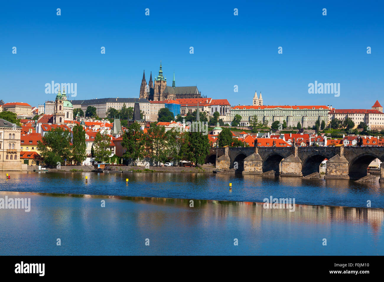 View across the Vltava River in Prague with Charles Bridge and the Castle - Stock Image