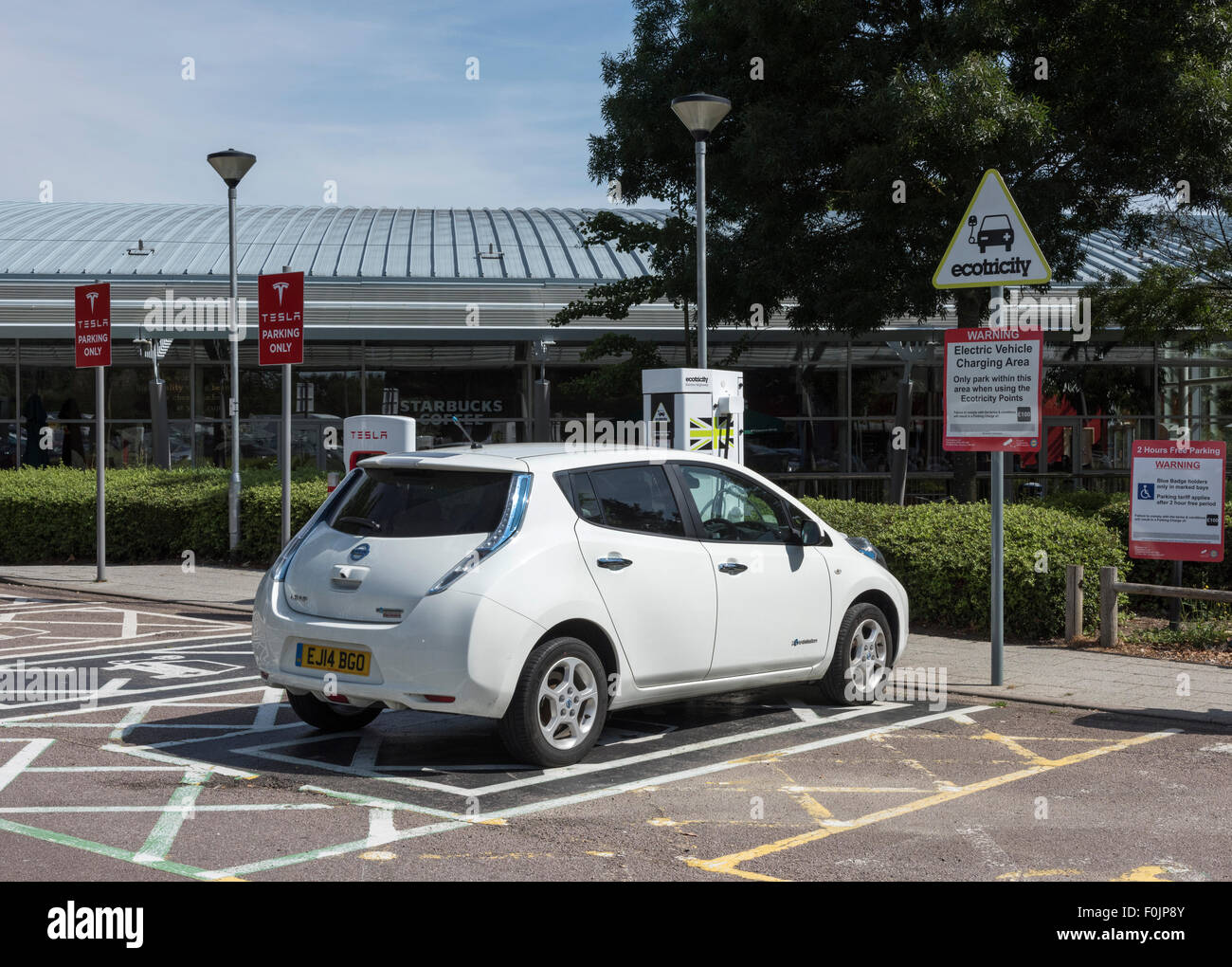 Nissan Leaf At Ecotricity Charging Point At Motorway Services UK   Stock  Image