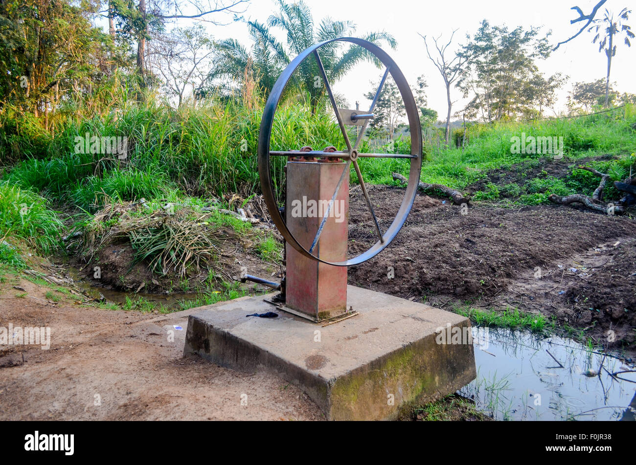Wheel pump for drinking water in rural Cameroon - Stock Image
