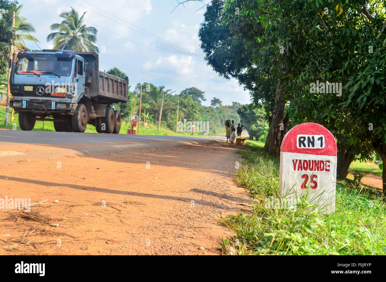 Milestone marking 25 km to Yaoundé, capital city of Cameroon, on the National Road 1 - Stock Image