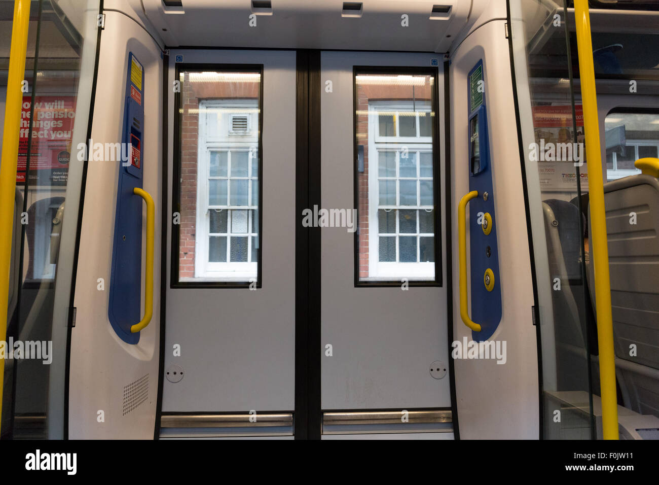 Closed doors at a railway station on a London Midland train & Closed doors at a railway station on a London Midland train Stock ...