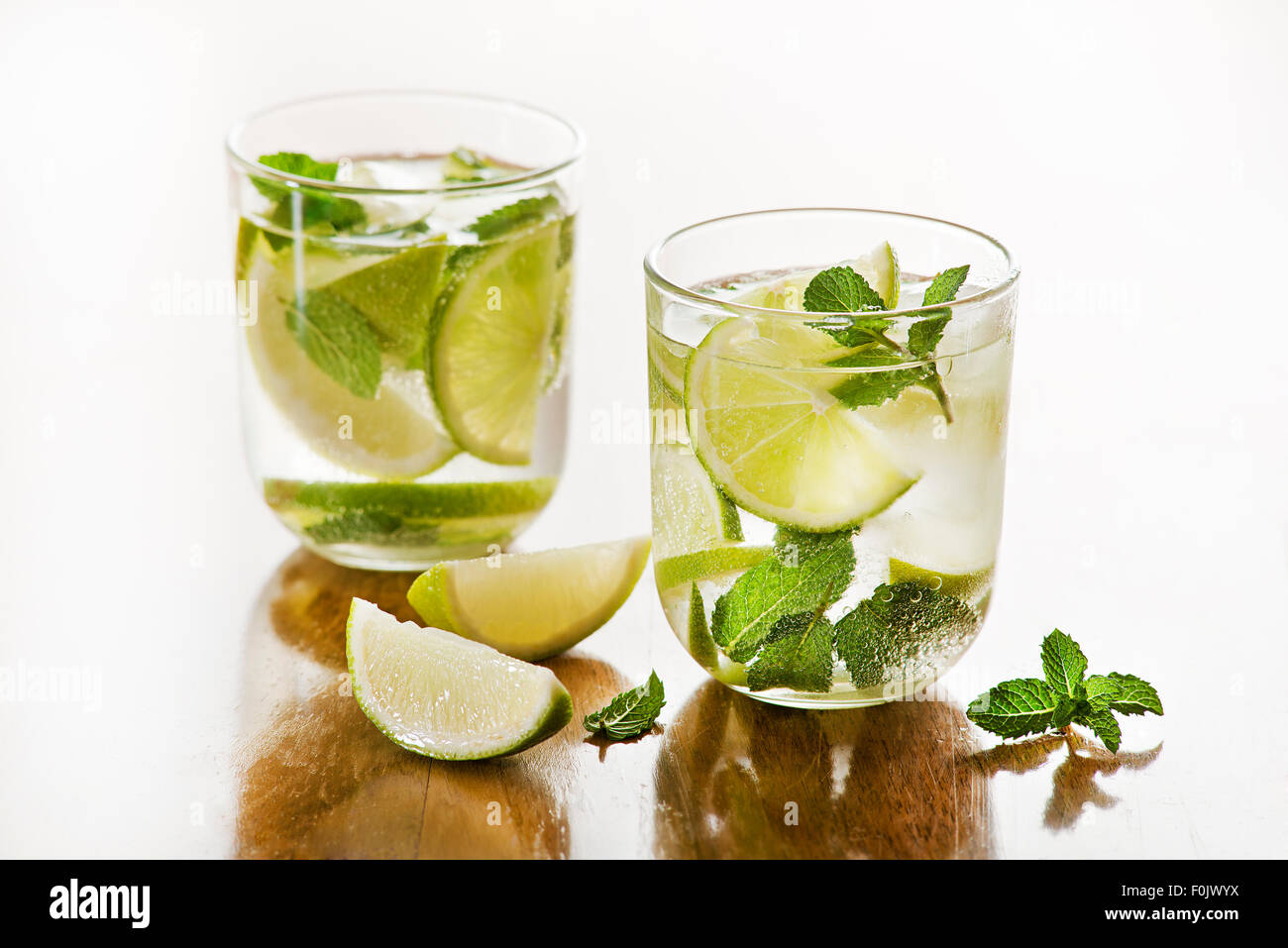 Cold Mojito cocktail on a rustic table. Stock Photo