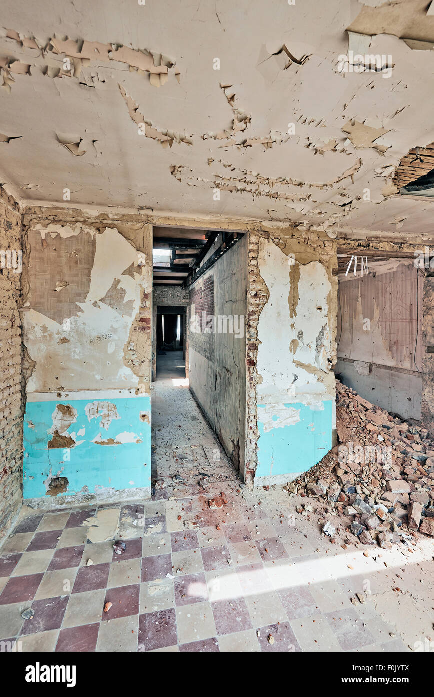 Large abandoned room under demolition before renovation Stock Photo