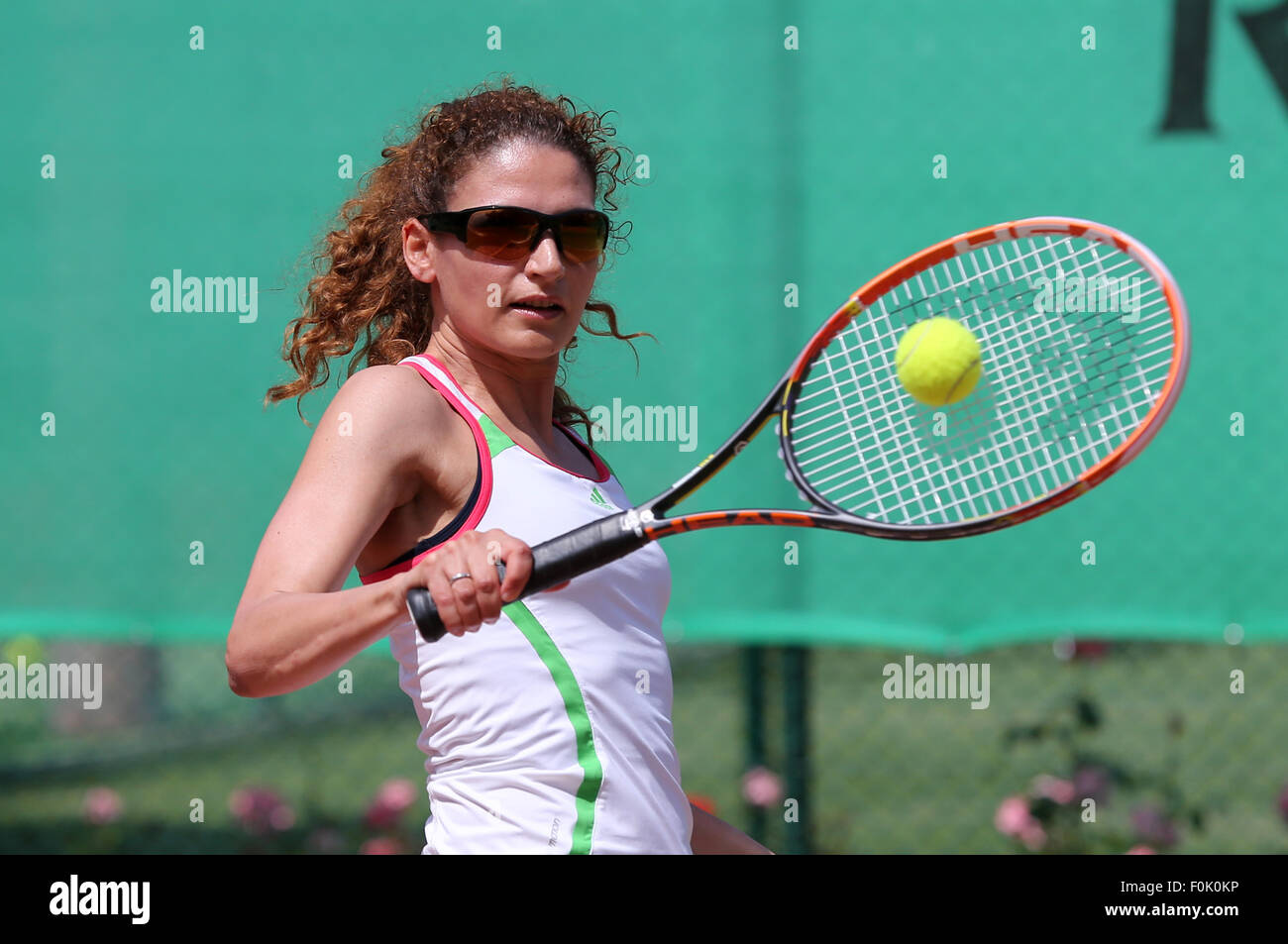 Young woman playing tennis. - Stock Image