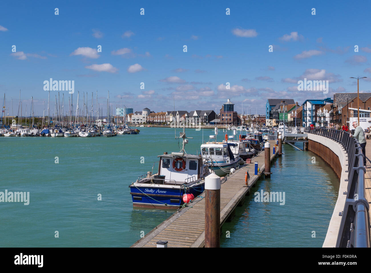 Littlehampton harbour at hight tide looking inland. - Stock Image