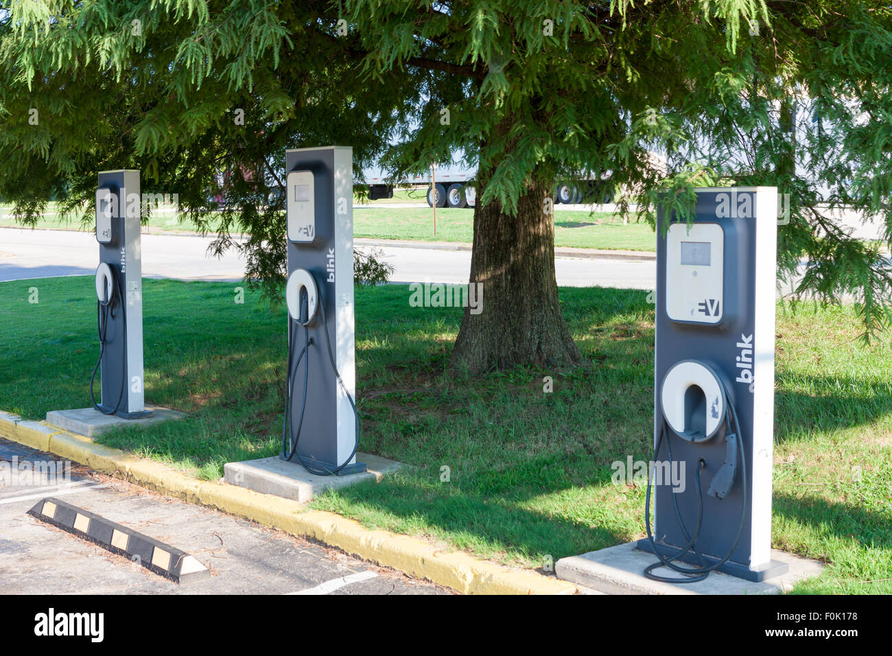 Blink EV charging stations sit idle waiting for the next electric vehicle to be charged. - Stock Image