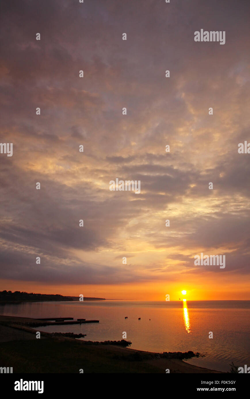 Sunrise over Kattegat strait in Fredericia city, Denmark. Kattegat is a sea strait connecting the North Sea and - Stock Image