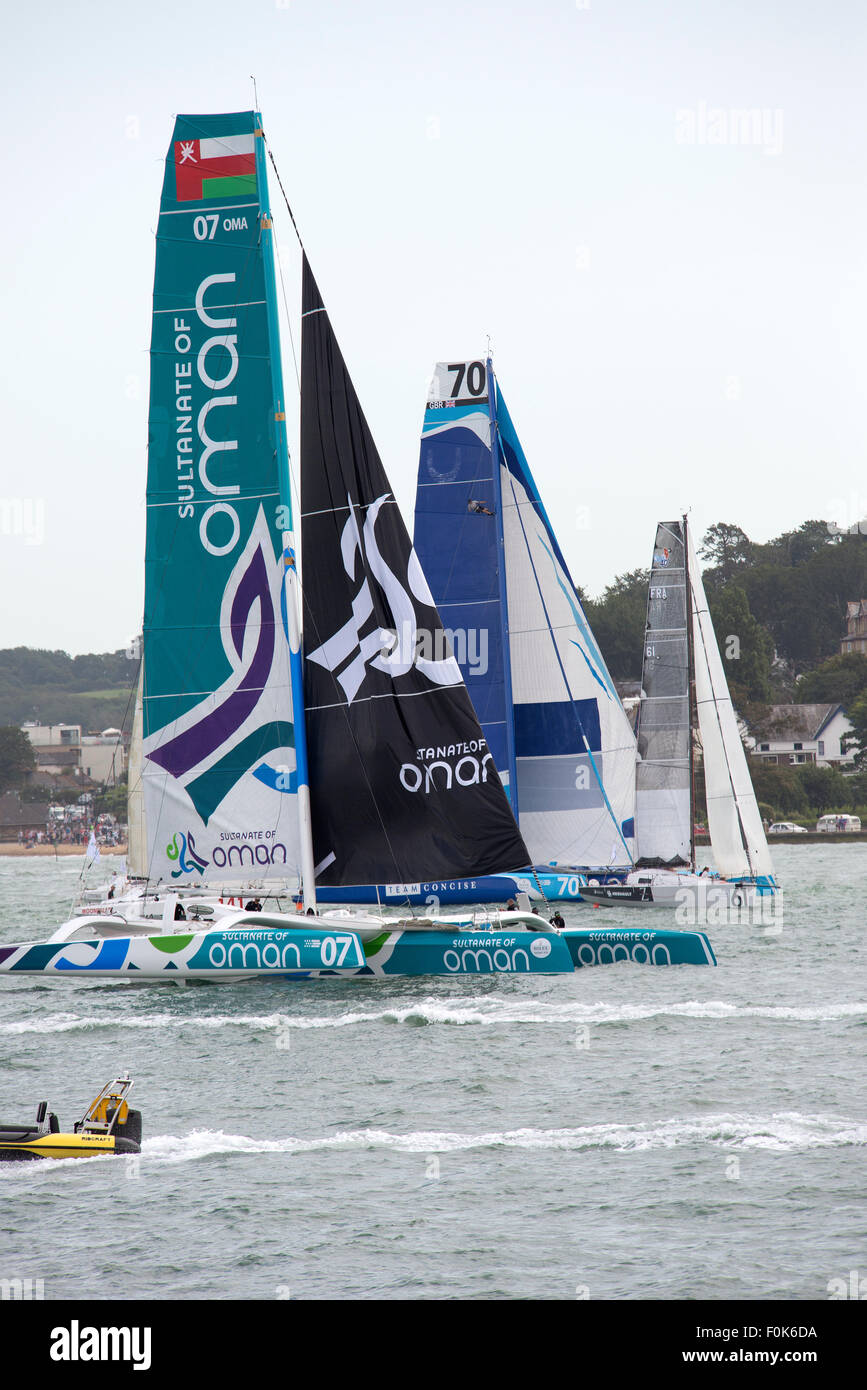 Sultanate of Oman and Team Concise racing yachts at the start of the Rolex Fastnet Race 2015 Cowes UK - Stock Image