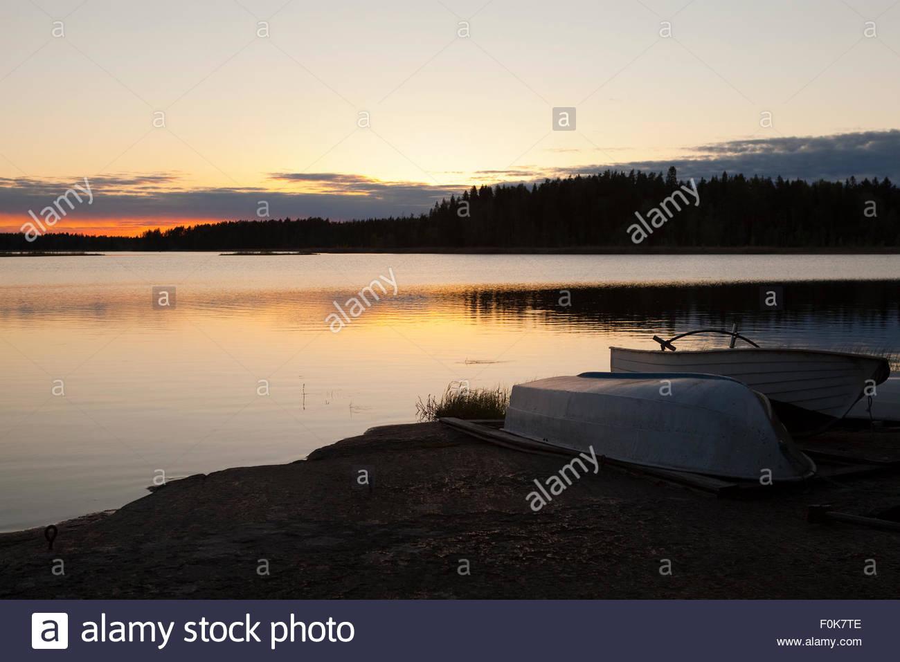 Boats upside down at lake Koskeljärvi - Stock Image
