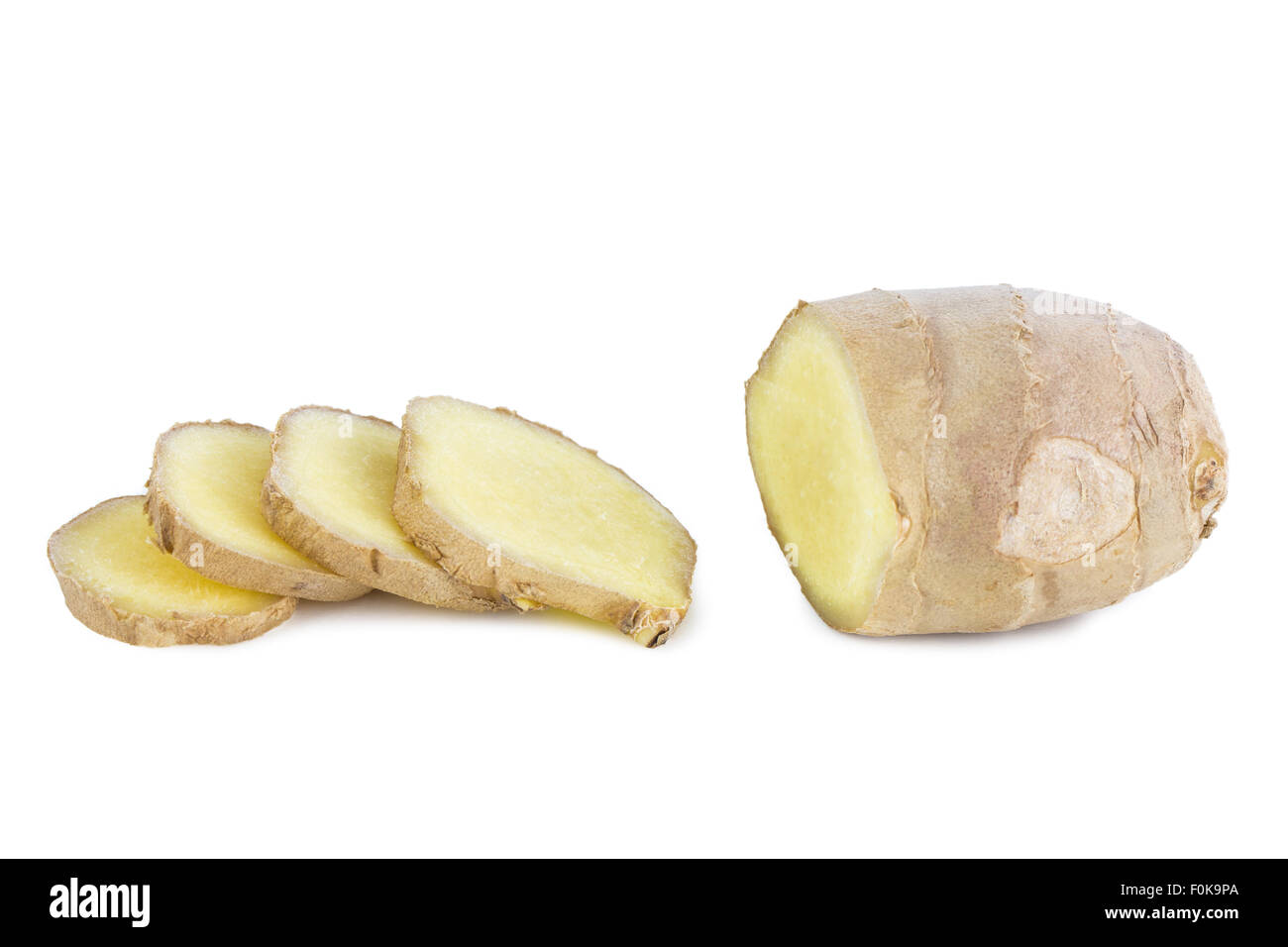 Close-up of piece and slices of fresh ginger root, isolated on white background. - Stock Image