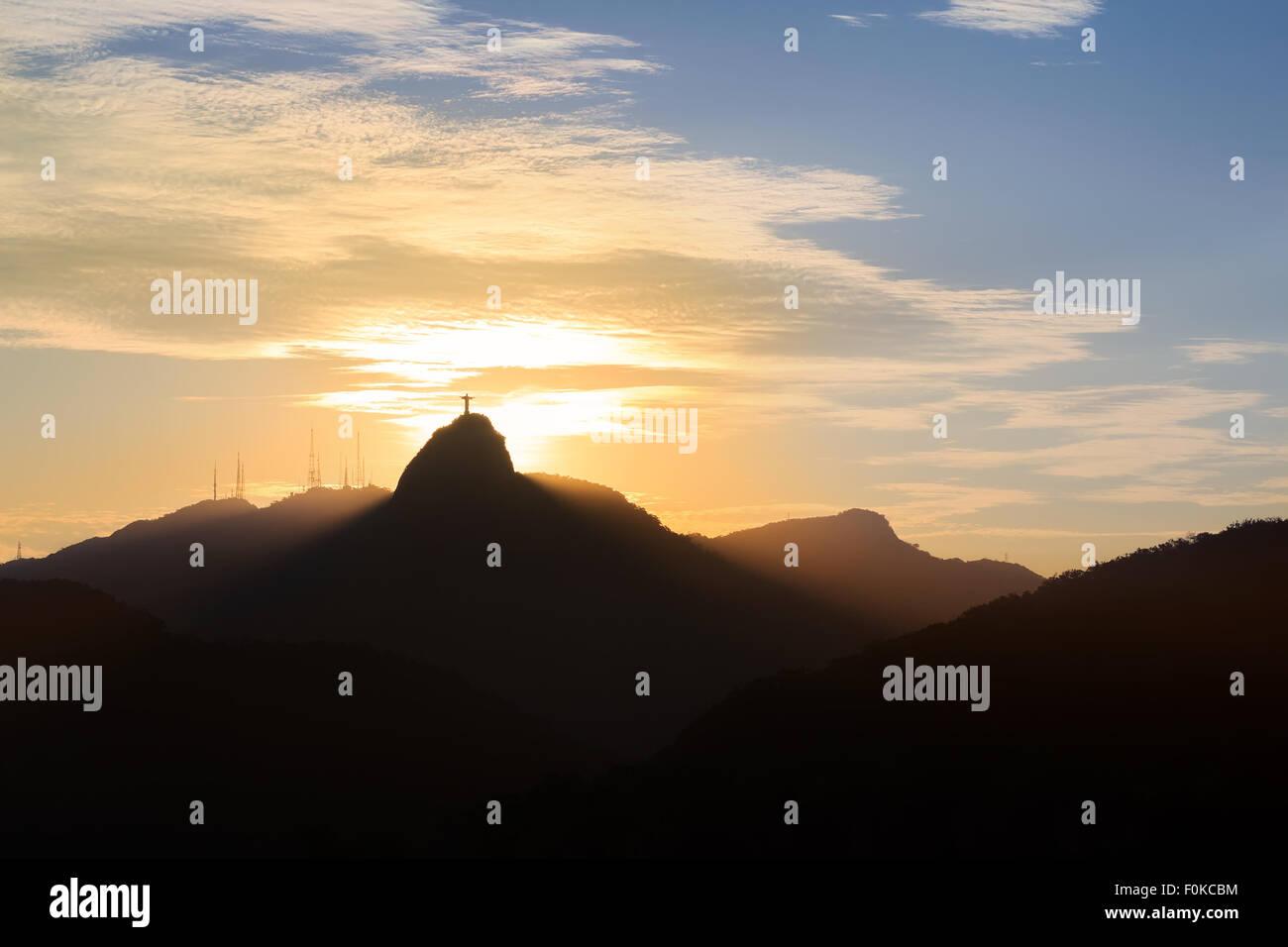 Sun light behind Mountain Corcovado Christ the Redeemer, sunset, Rio de Janeiro, Brazil Stock Photo