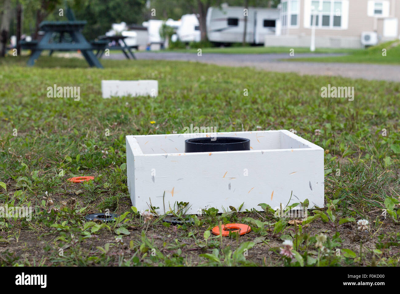 washers tossing game on grass on a camping.It is a game, similar to horseshoes - Stock Image