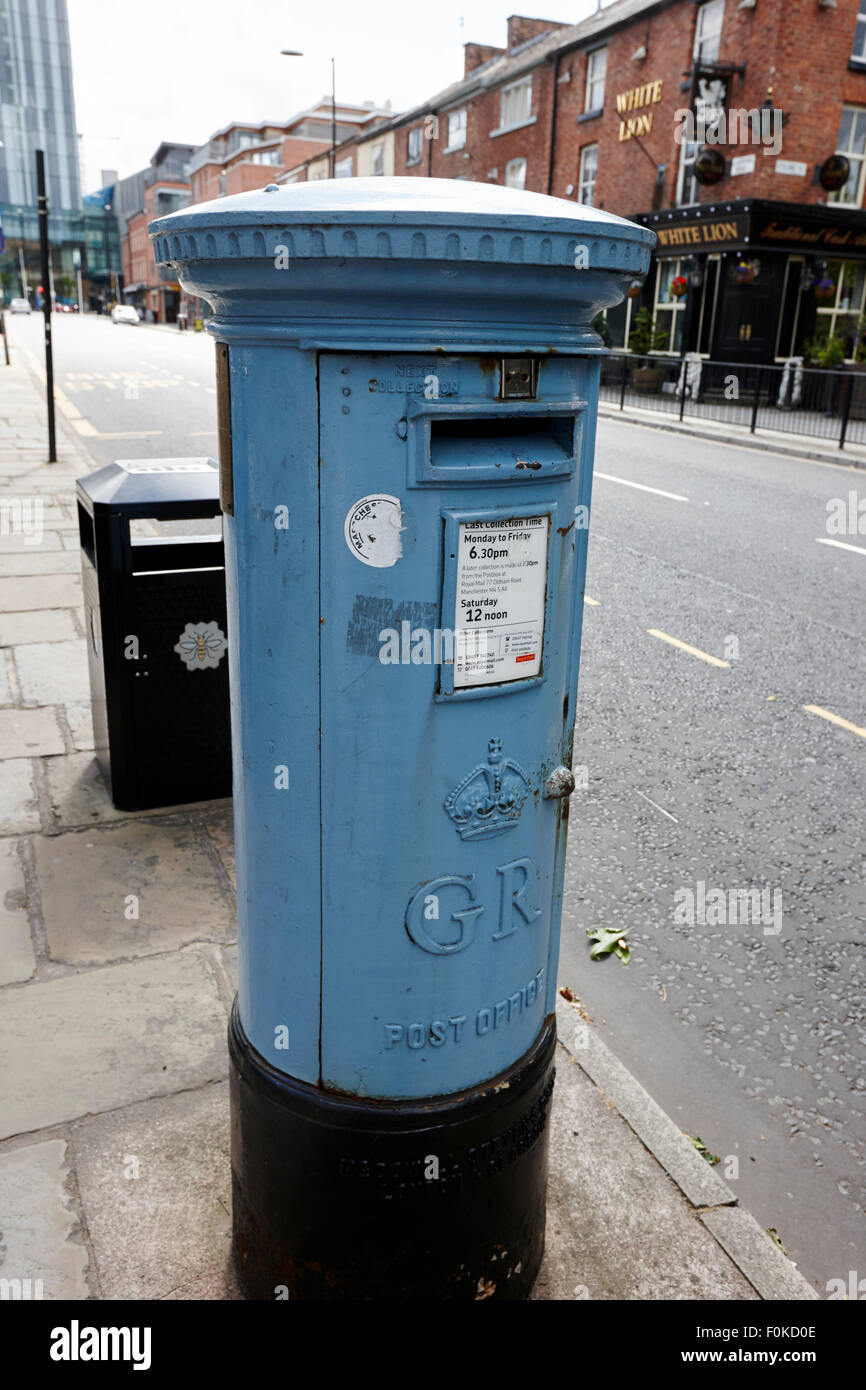 postbox painted in the blue to signify a specialist airmail box on manchesters liverpool street uk - Stock Image