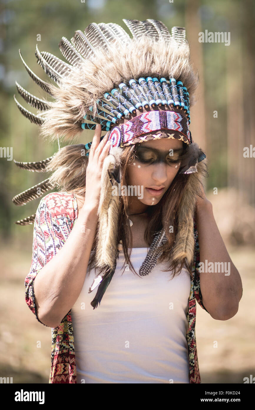 Young woman masquerade as an Indian - Stock Image