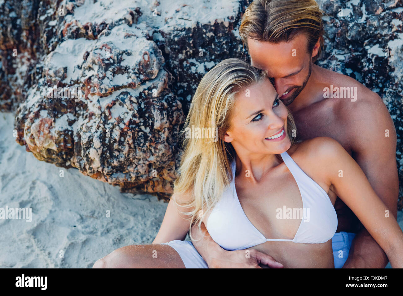 Couple in love on the beach - Stock Image