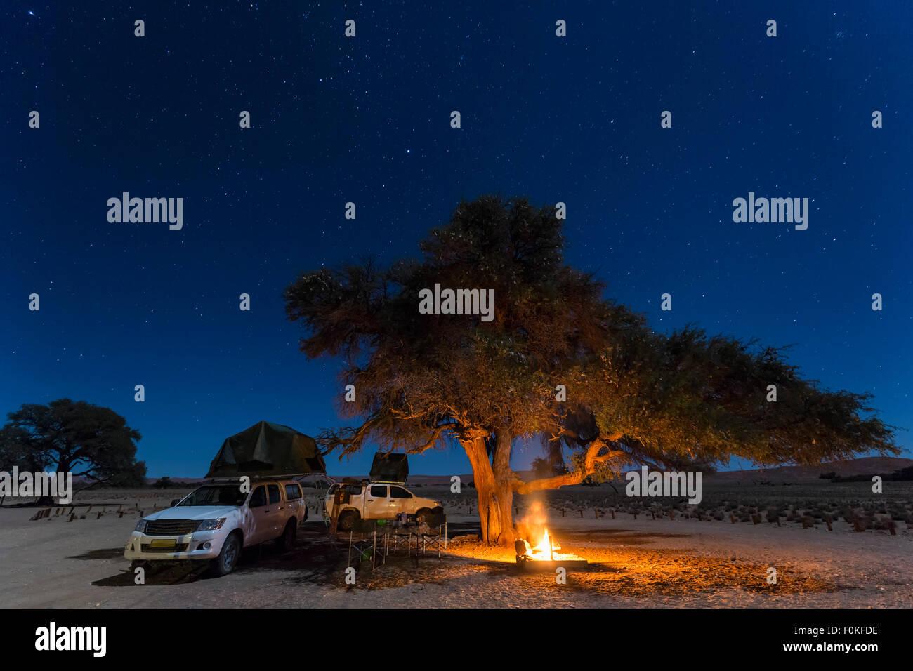 Namibia, Namib Desert, Namib Naukluft National Park, camping with camp fire by night - Stock Image