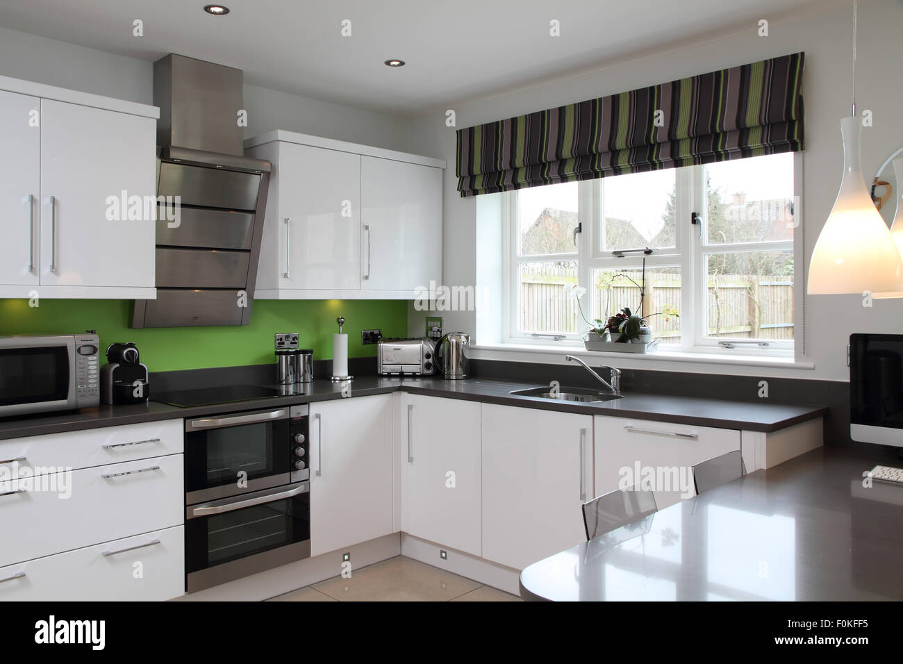 Black and White modern kitchen with lime green splash back ...