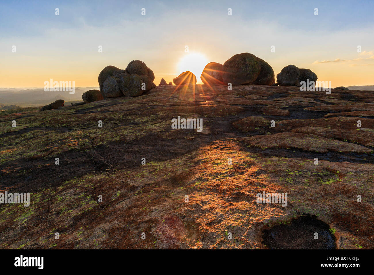 Africa, Zimbabwe, Matobo National Park, Rock formation with tomb of Cecil Rhodes at sunset - Stock Image