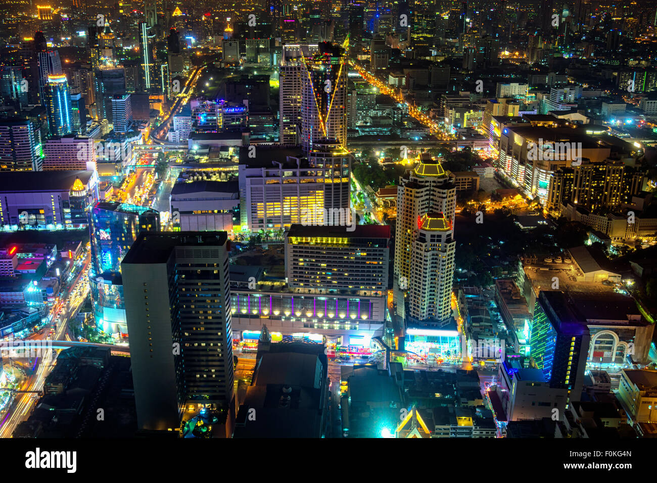 Brightly Lit, Nightime Skyline of a Major Metropolitan City in Asia, with towers and heavy traffic. - Stock Image
