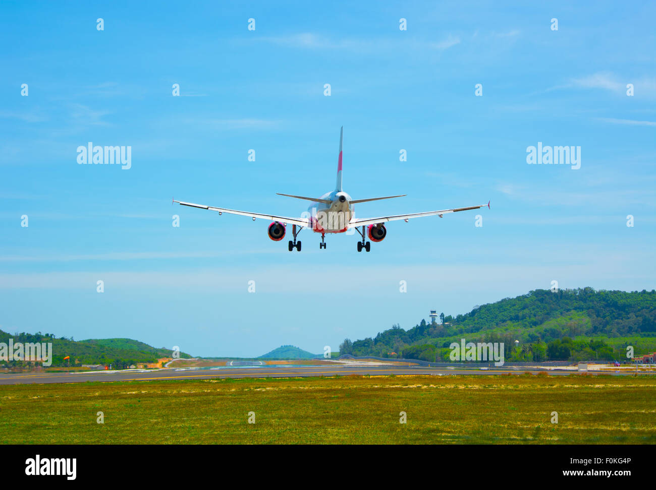 Twin-engine, modern, big commercial airliner coming for a landing at an airport - Stock Image