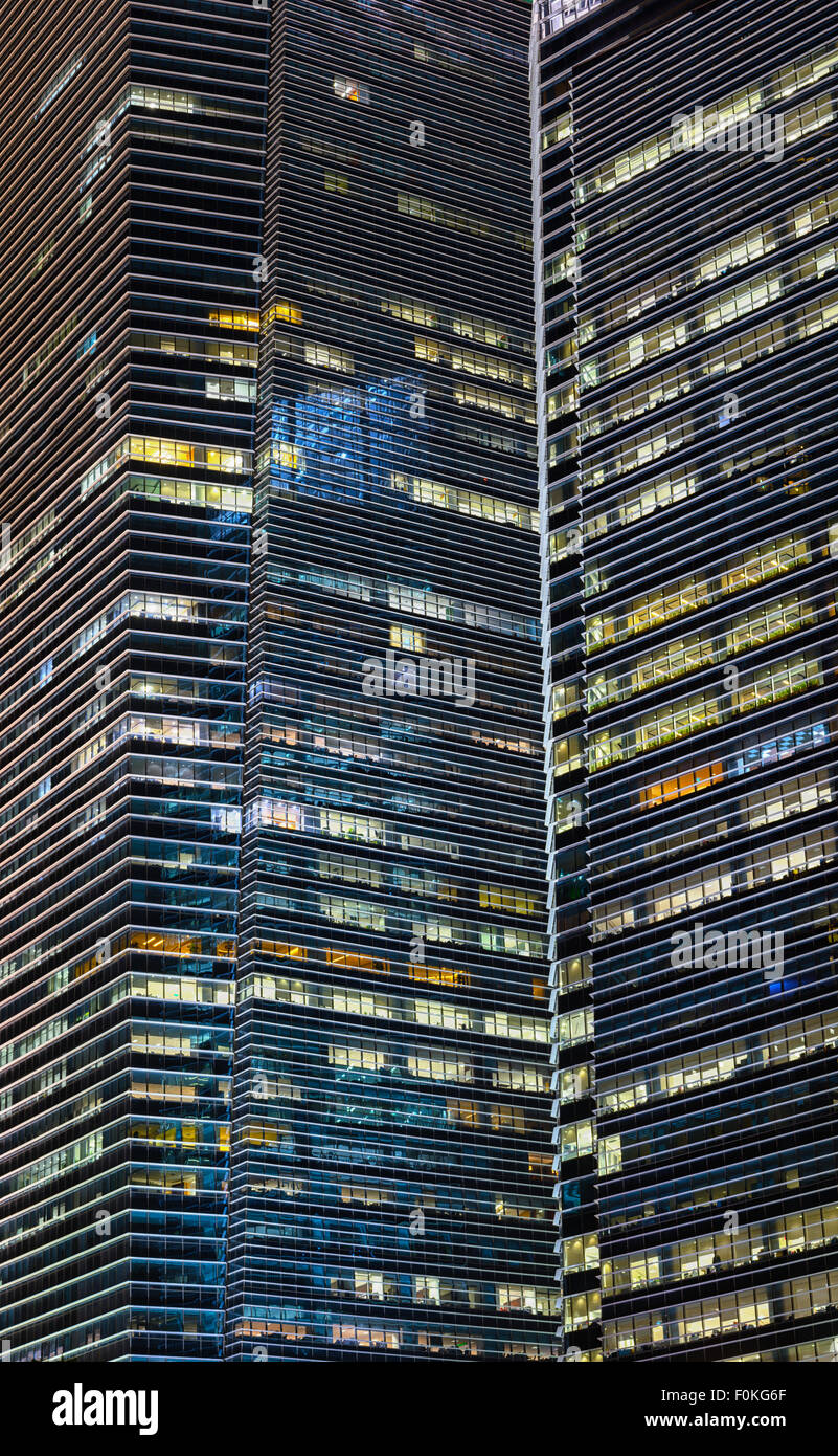 Extreme zoom shot of these urban sky scrapers at night, reveals their simplistic and angular architectural style. - Stock Image