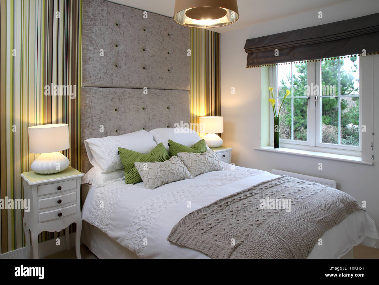 New bedroom with side tables and lamps. Double height ...
