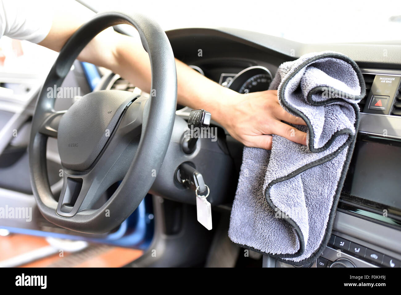 Man Cleaning Car Interior