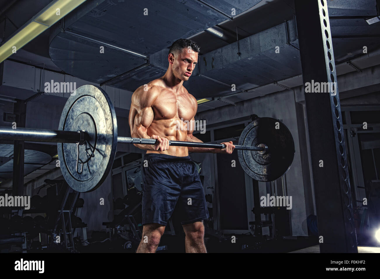 Physical athlete weightlifting - Stock Image
