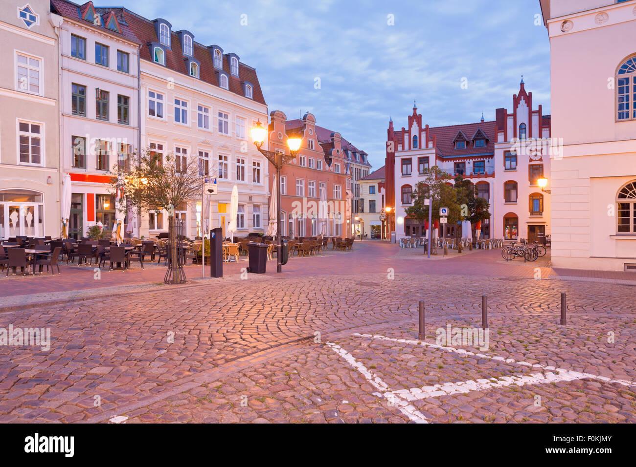 Germany, Wismar, market square at twilight - Stock Image