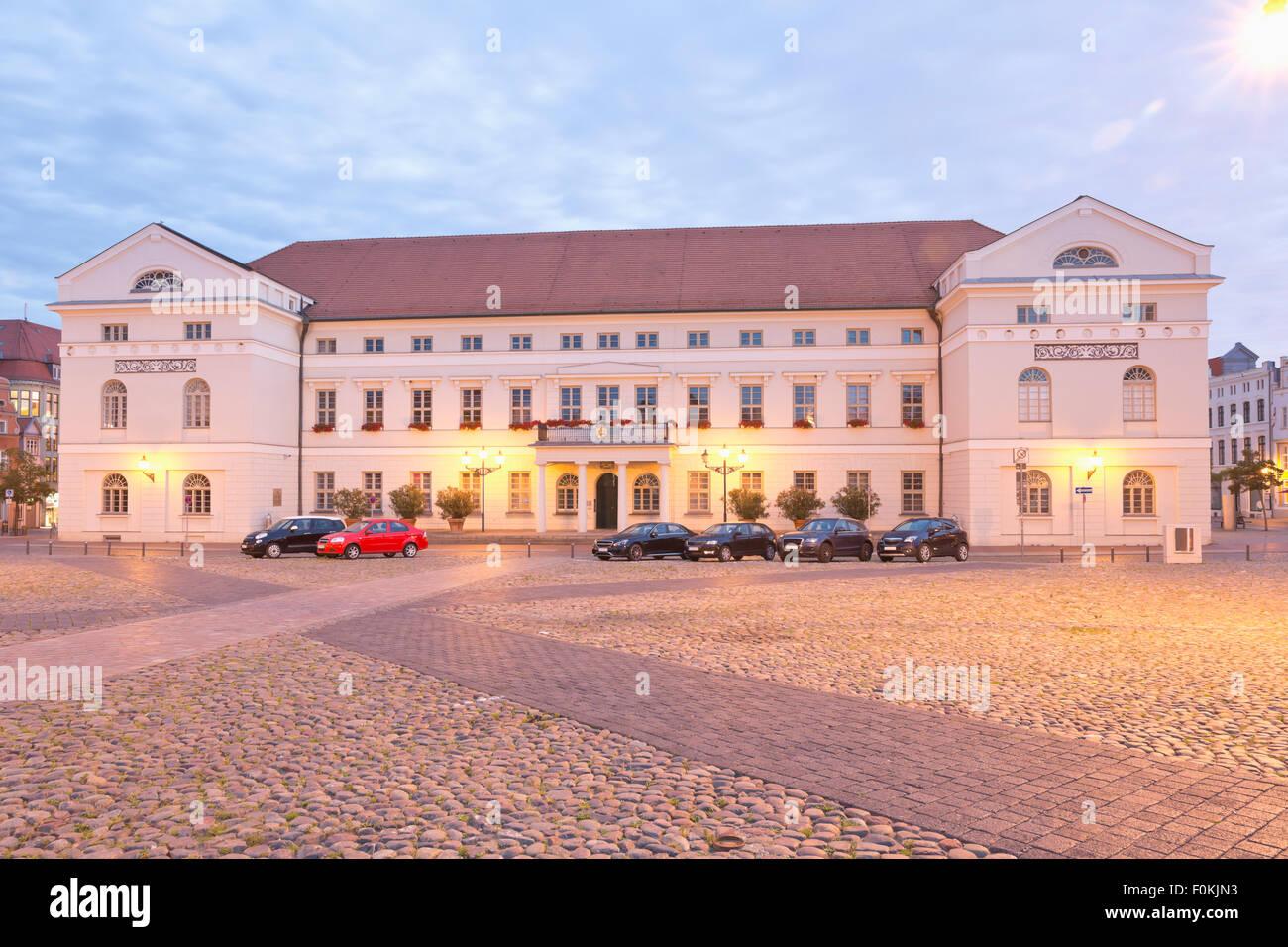 Germany, Wismar, city hall at twilight - Stock Image