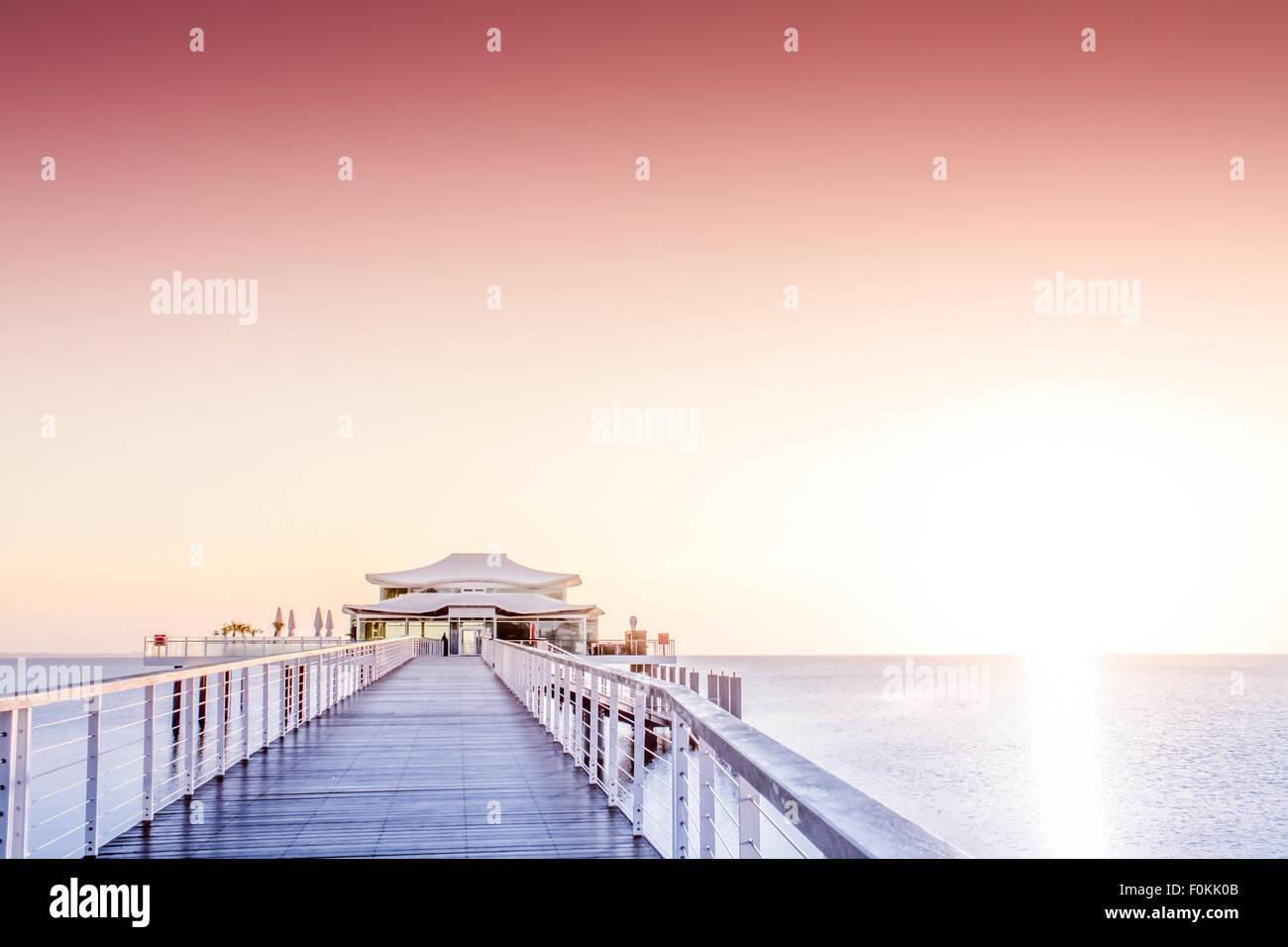 Germany, Niendorf, sea bridge with tea house at sunrise Stock Photo