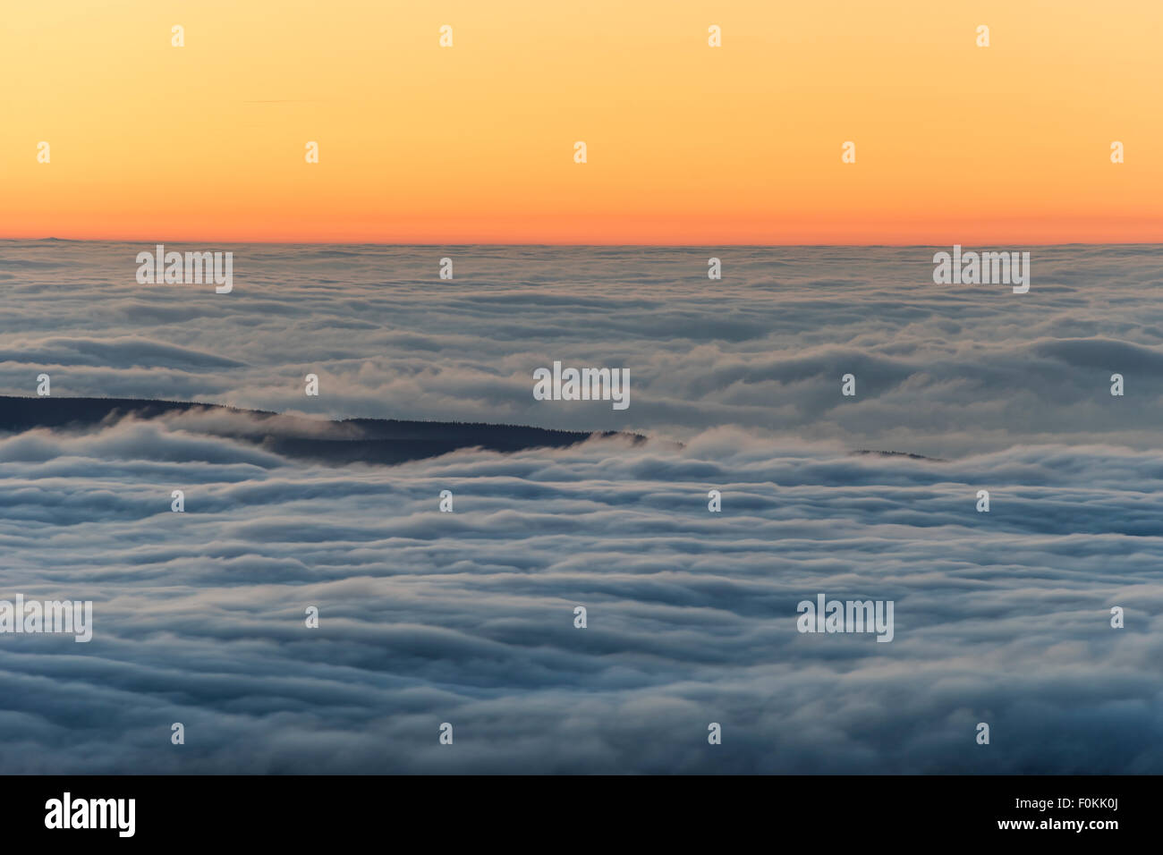 Germany, Saxony-Anhalt, cloud cover above Harz National Park at sunset - Stock Image