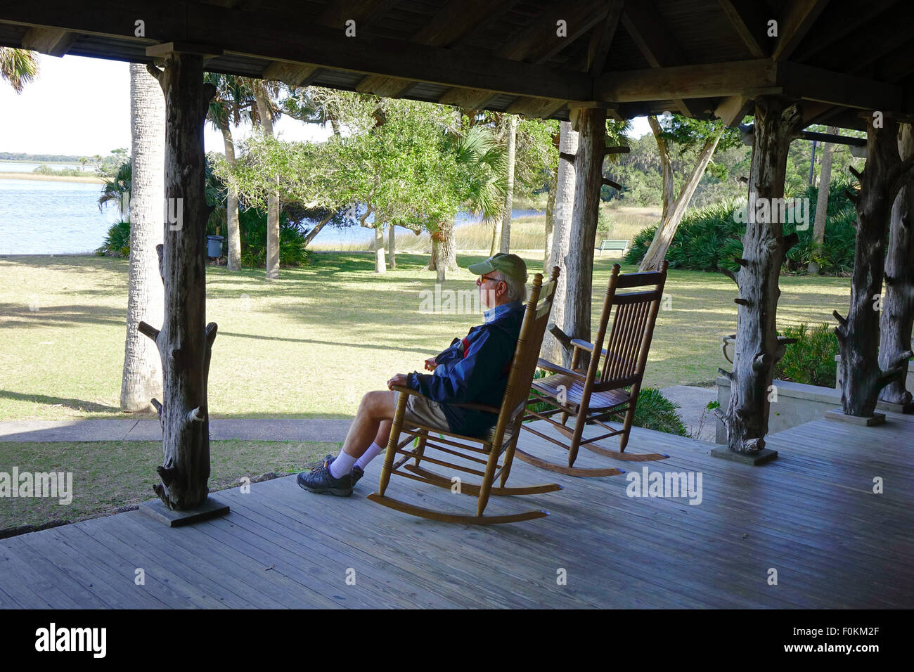 Man In A Rocking Chair On The Porch Of The Lodge At Princess Place  Preserve, Flagler County Florida