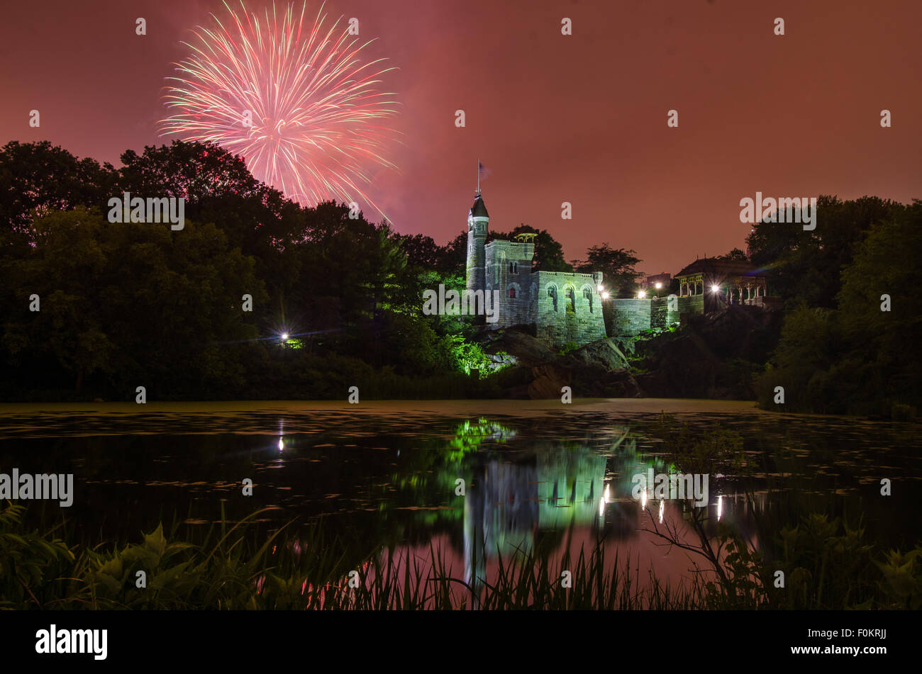 Fireworks explode over Belvedere Castle in Central Park in celebration of the New York Philharmonic's 50th anniversary. - Stock Image