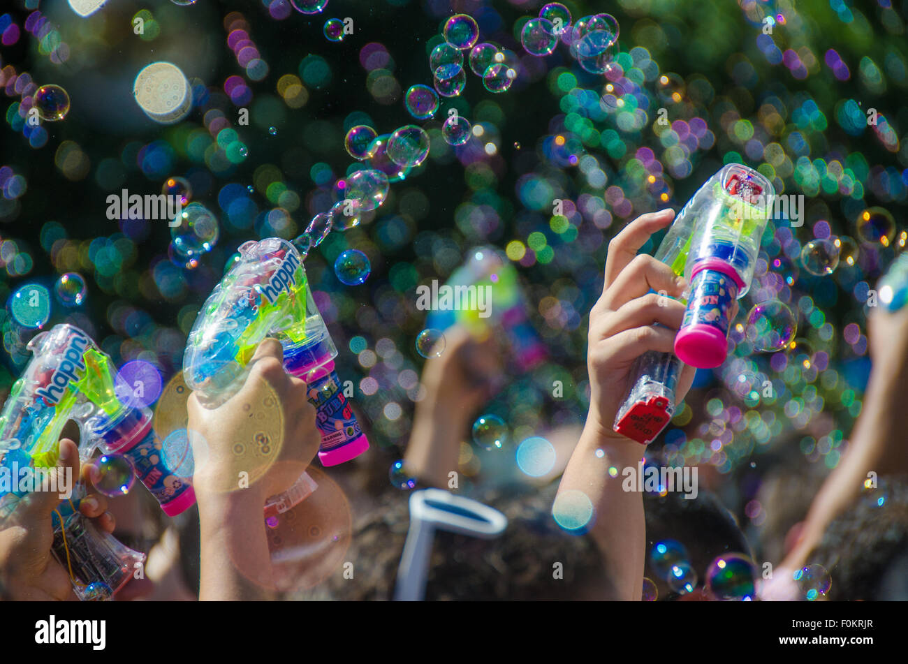 Millions of bubbles float through the air at New York City's annual buble gun battle in Union Square Park. - Stock Image