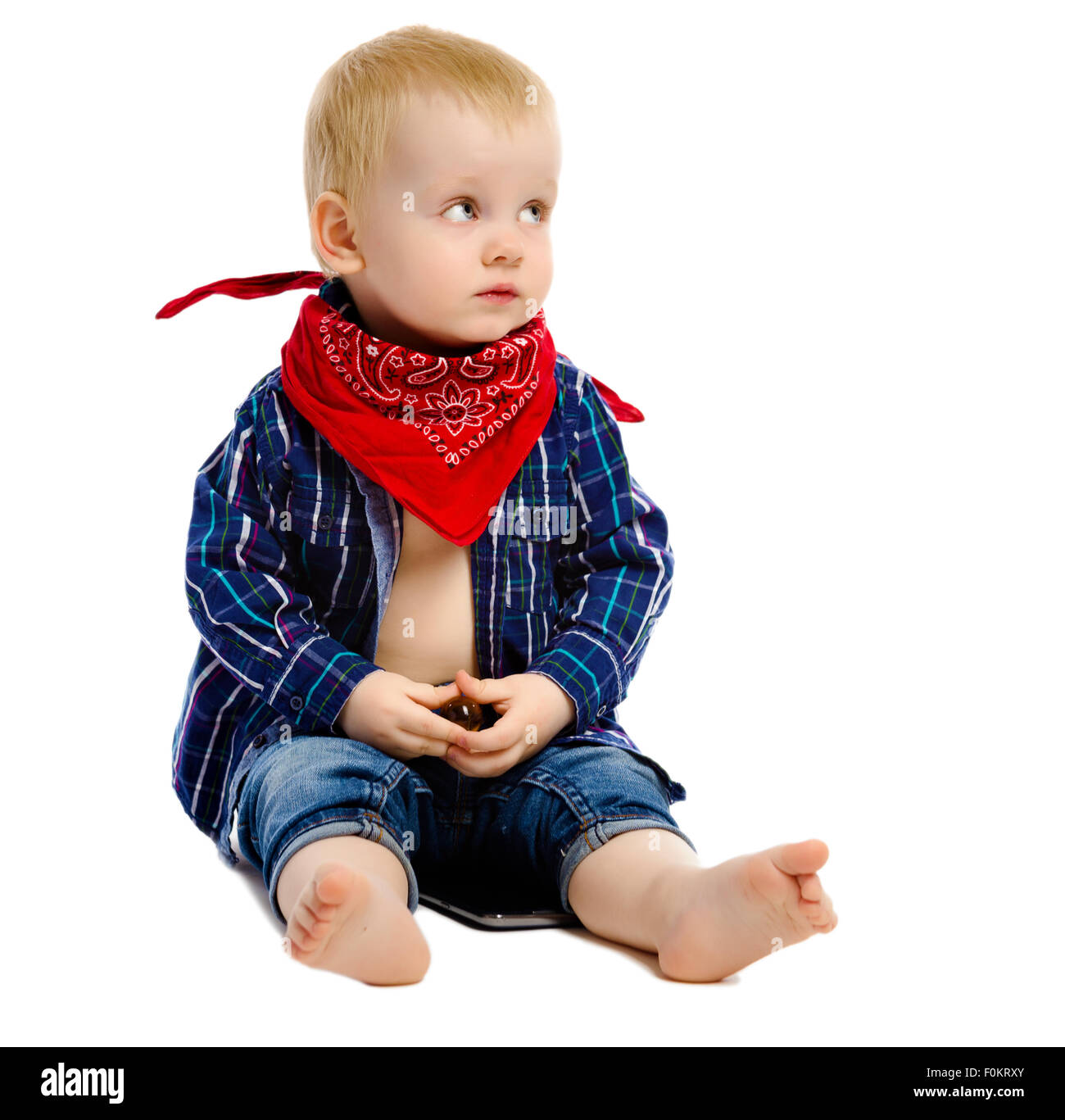 Little boy in gangster kerchief around his neck on a white background - Stock Image