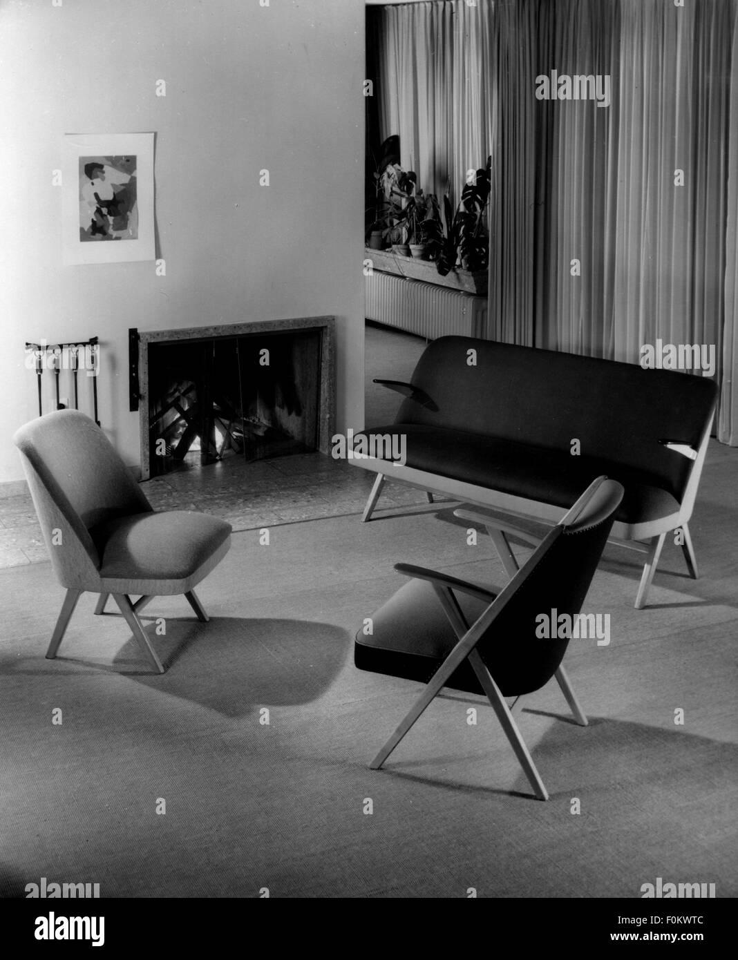 furnishings, seats with fireplace, 1950s chairs, chair, sofa, settee, sofas, settees, couch, chaise, chaise longue, - Stock Image