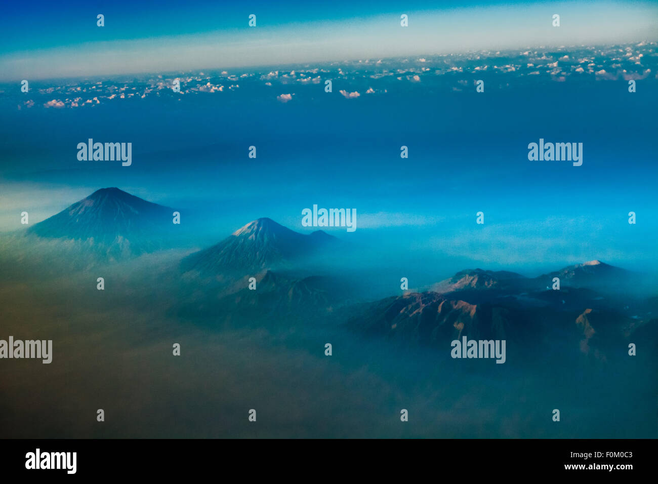 Aerial view of Mount Sumbing, Sundoro, and Dieng Plateau in Central Java, Indonesia. © Reynold Sumayku - Stock Image