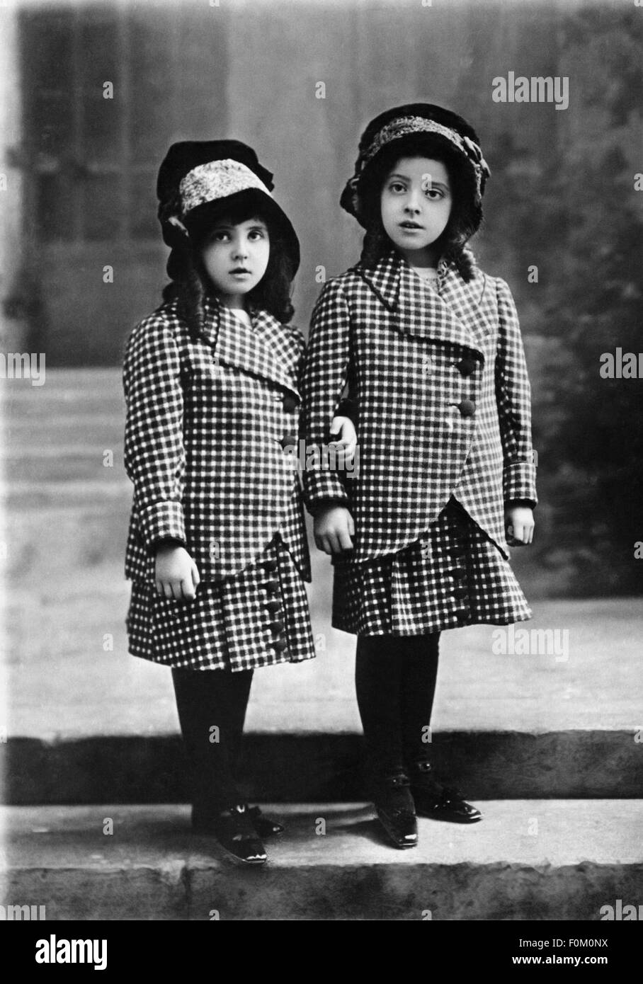 Fashion Childrens Fashion Two Girls Wearing The Same Womans Suit