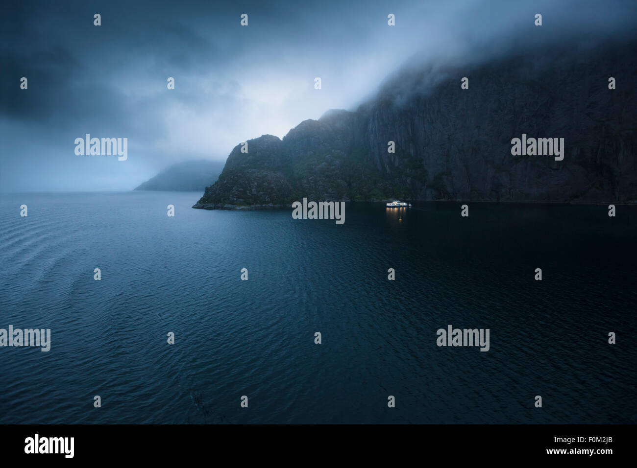 Mystical, foggy evening mood in a fjord, Norway - Stock Image