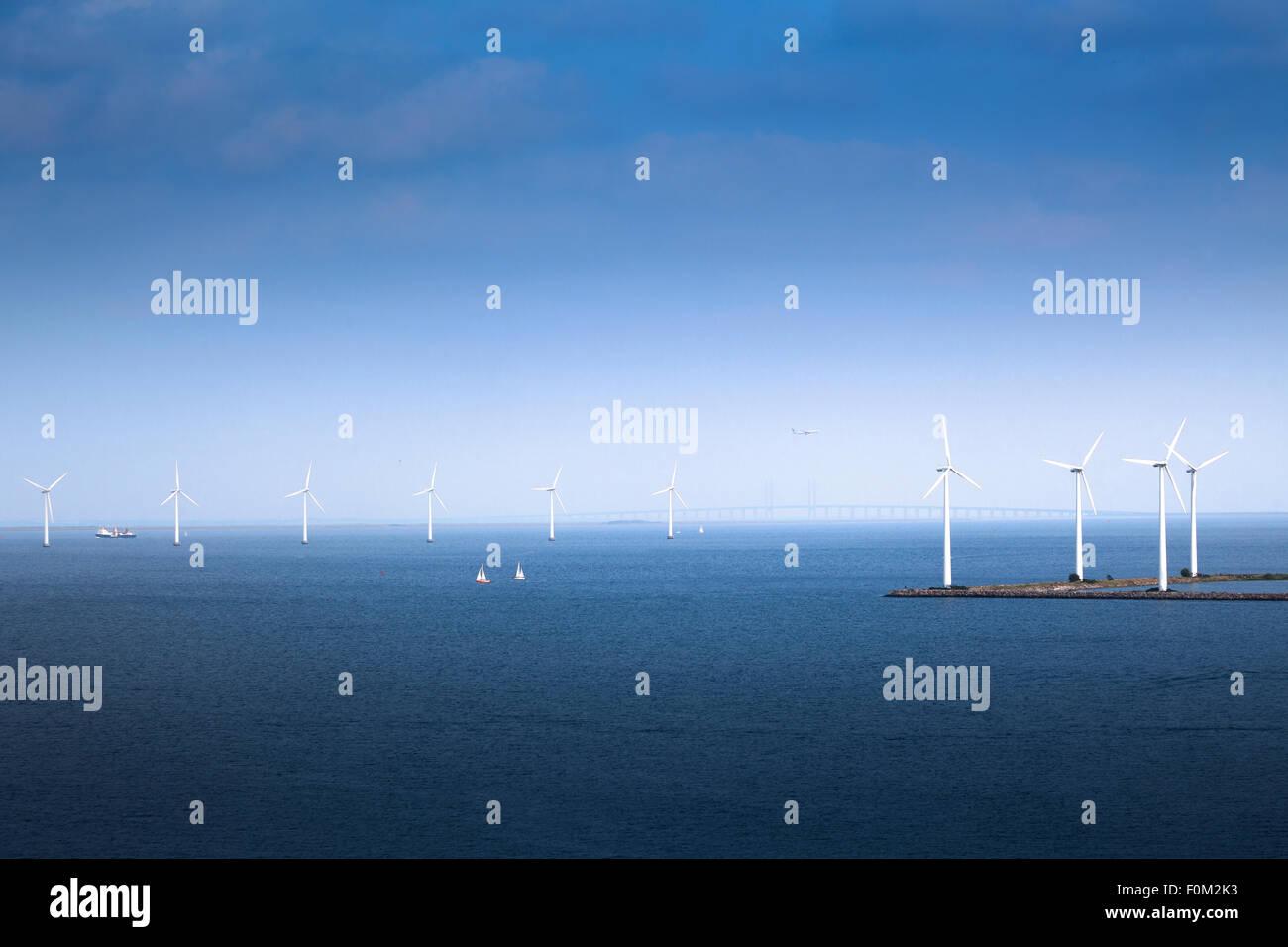 Wind farm in Öresund with Oresund Bridge, Copenhagen, Denmark - Stock Image