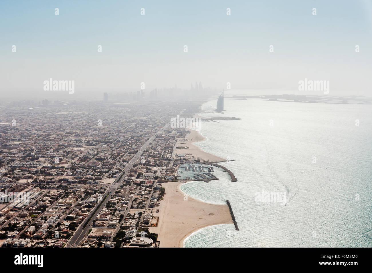 Coast with Burj Al Arab, Dubai Marina and Palm Island, Dubai, UAE - Stock Image